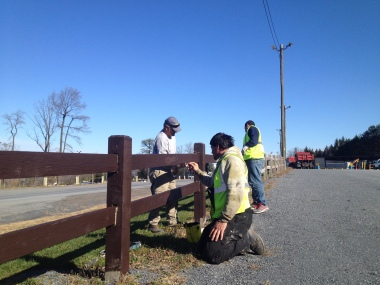 Gerry & Chris painting lot fences.
